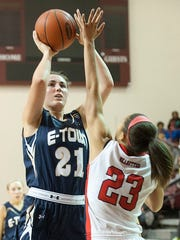 Elizabethtown Panthers forward-center Erin Boley puts up a shot over the outstretched arms of Butler Bearettes guard Jaelynn Penn.