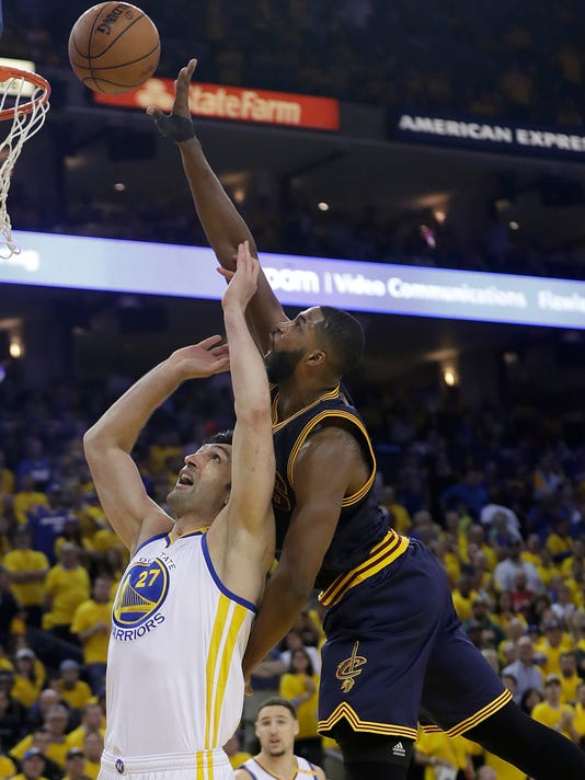 Cleveland Cavaliers center Tristan Thompson, right, shoots against Golden State Warriors center Zaza Pachulia during the second half of Game 1 of basketball's NBA Finals in Oakland, Calif., Thursday, June 1, 2017. (AP Photo/Marcio Jose Sanchez)
