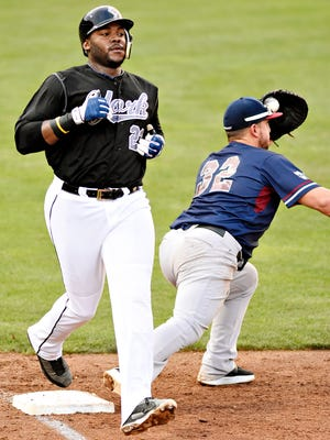 York Revolution's Telvin Nash, left, is out at first after a catch by Somerset Patriots' Mark Minicozzi during Atlantic League baseball action at PeoplesBank Park in York City, Monday, Aug. 21, 2017. Nash went 2 for 4 with three RBIs in York's 7-0 win over Somerset on Tuesday night to remain atop the Freedom Division standings. Dawn J. Sagert photo