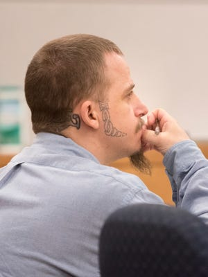 Robert Hunt listens to testimony in his murder trial Wednesday in Pensacola. He was convicted of second-degree murder for stabbing a fellow inmate to death in 2017.