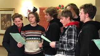 Members of the Hamilton High School football team sing Christmas carols to residents at the Brookdale Senior Living Center in Sussex.