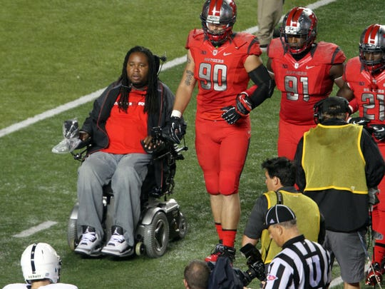 Eric LeGrand serves as an honorary co-captian for Rutgers' game against Penn State on Sept. 13.