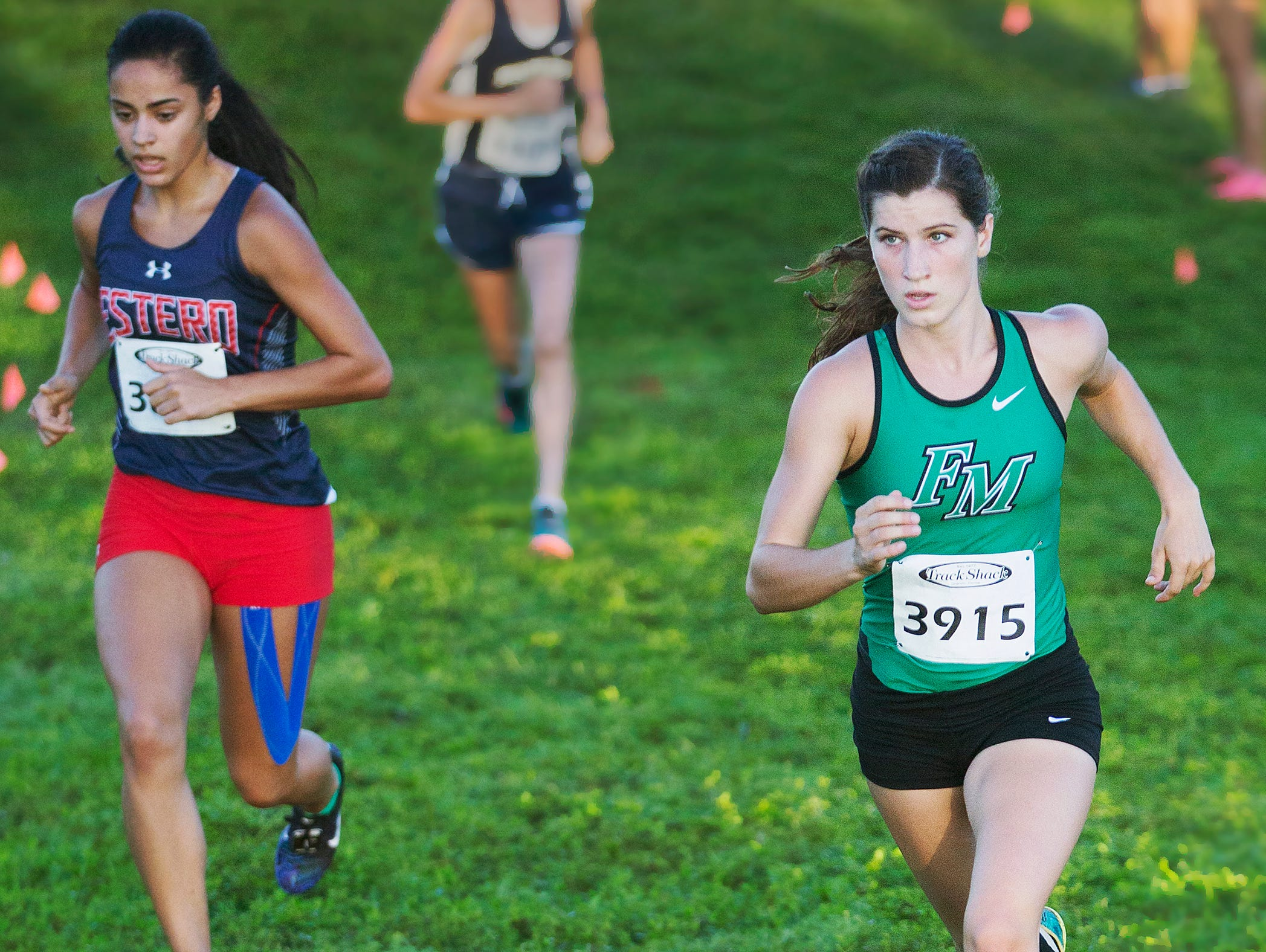 Fort Myers High School's Kristlin Gear, right, competes in the Hoptar Invitational at Veterans Park in Lehigh Acres on Saturday. Gear won the race.