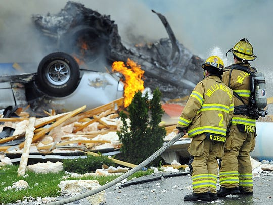 Firefighters work to put out fires following an explosion