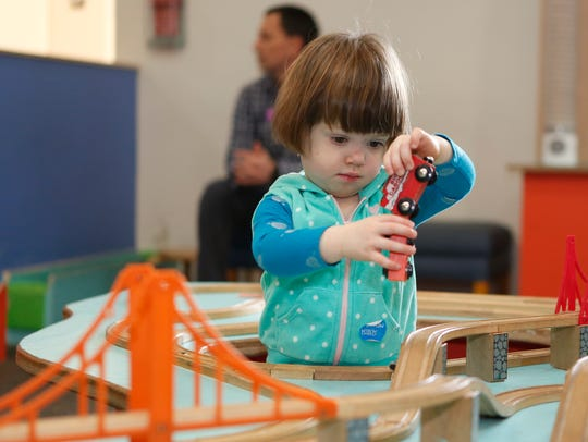 Livia Dozier, 2, from Poughkeepsie plays with the trains during a children's New Year's Eve party at the Mid-Hudson Children's Museum in Poughkeepsie on Dec. 31, 2016.