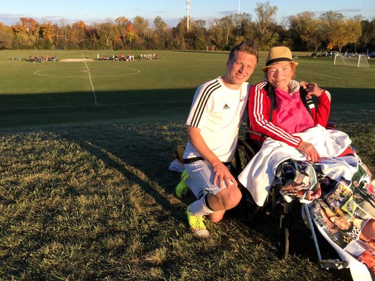 John Oberg, 28, and his mom, Karen Oberg, 61, both of Clinton Township, at the Sterling Heights park  where John plays soccer on Sundays. Karen Oberg has terminal cancer and is the subject of Jim Schaefer's column this week.