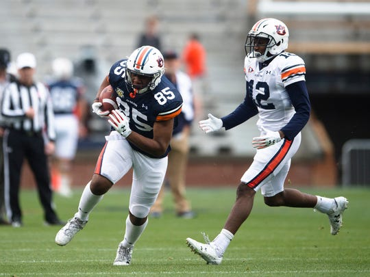 Auburn tight end Jalen Harris (85) catches a pass as Auburn corner Jamel Dean (12) defends during A-Day game on Saturday, April 7, 2018, in Auburn, Ala.