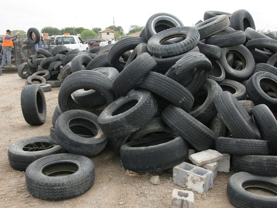 In this photo, piles of tires wait to be loaded into a trailer in Clint.