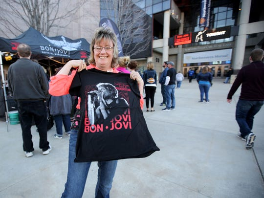 Brenda Murray, of Laona holds up her newly purchased Bon Jovi shirt outside the Bradley Center.