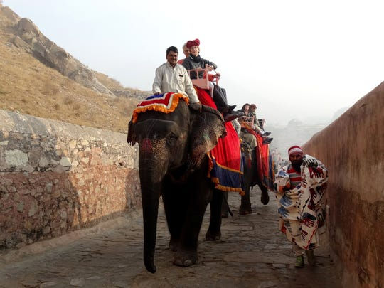 The hilltop Amer Fort outside Jaipur stands high above a medieval village, a climb made easier if you ride an elephant.