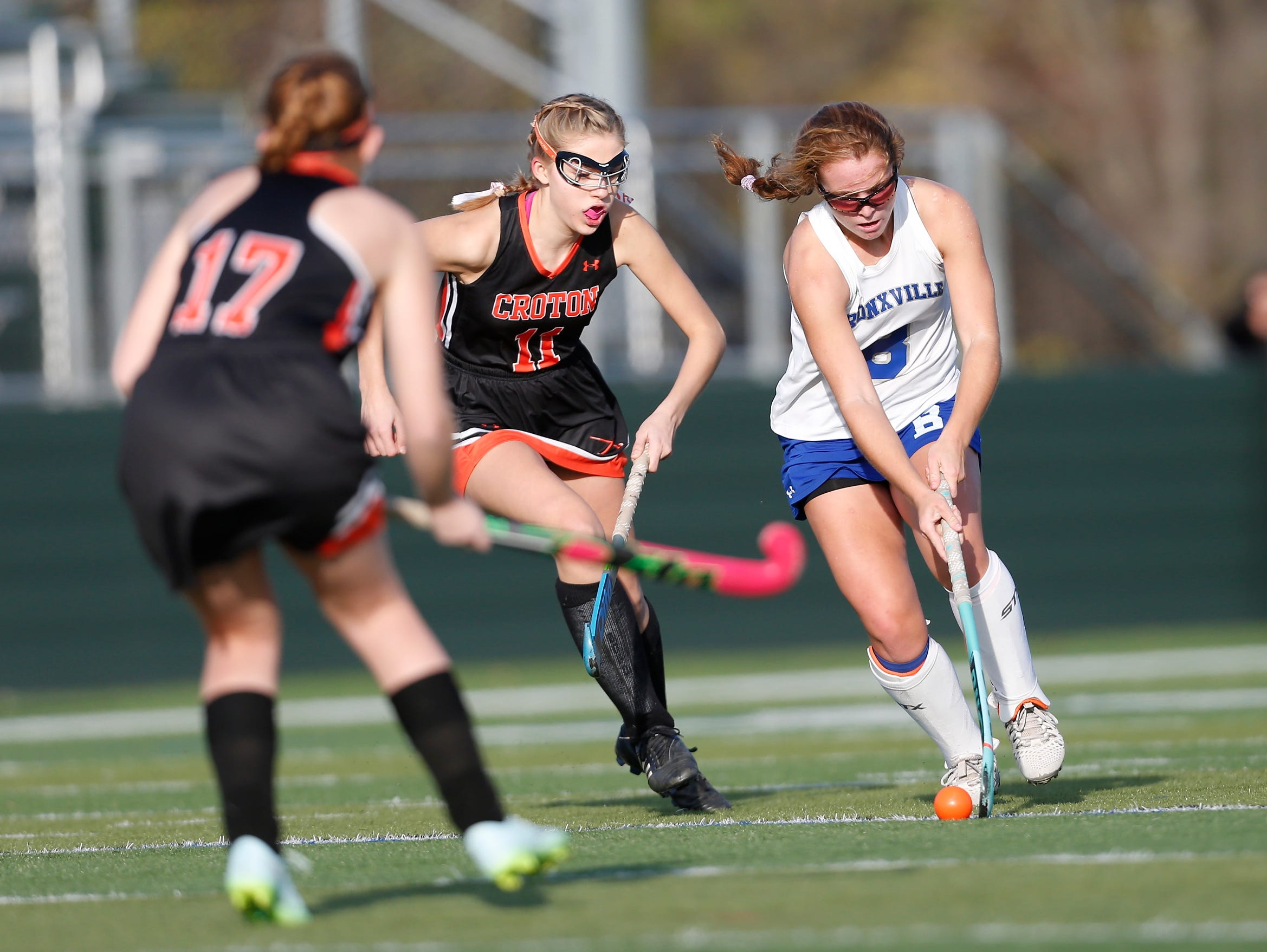Bronxville's Ellie Walsh (8) works the ball past Croton's Julia Danett (11) during their 7-1 win in the Class C field hockey sectiion finals at Brewster High School on Tuesday, November 1, 2016.