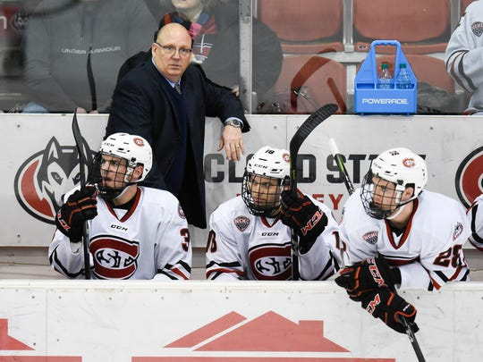 St. Cloud State head coach Bob Motzko watches from the bench during the first period of the Sunday, March 11, 2018,  game at the Herb Brooks National Hockey Center in St. Cloud.