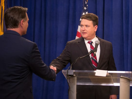 Luke Messer (left), shakes the hand of Todd Rokita, prior to a debate of Indiana Republican candidates for Senate, at WISH TV, Indianapolis, Sunday, April 15, 2018.