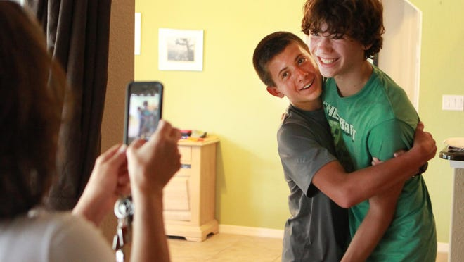 Logan, right, and Chase joke around for one last photo together before Chase moves to Colorado.