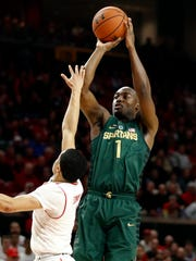 Michigan State guard Joshua Langford shoots over Maryland