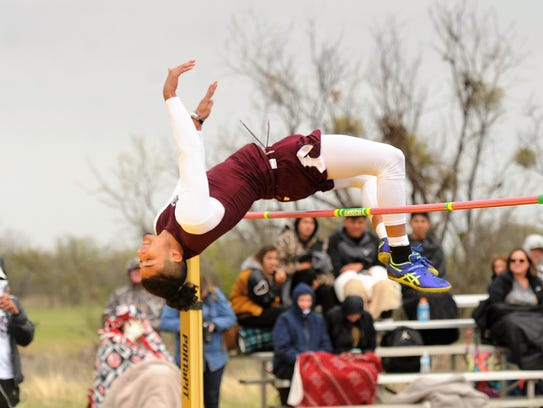 Brownwood's Nic Salazar clears the bar during the District