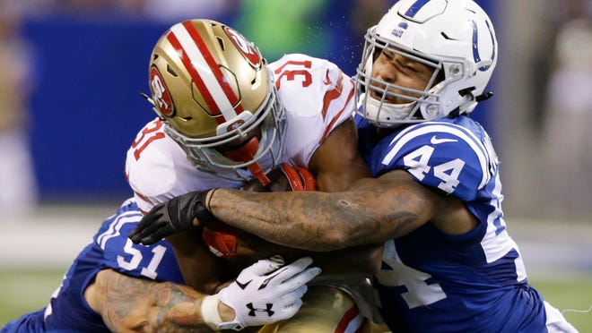 FILE - In this Sunday, Oct. 8, 2017 file photo, San Francisco 49ers' Raheem Mostert (31) is tackled by Indianapolis Colts' John Simon (51) and Antonio Morrison (44) during the second half of an NFL football game in Indianapolis. The Colts traded inside linebacker Antonio Morrison to the Packers for cornerback Lenzy Pipkins, giving each veteran one chance to impress their new coaches and a better chance of making the 53-man active roster on their new teams.(AP Photo/Michael Conroy, File)