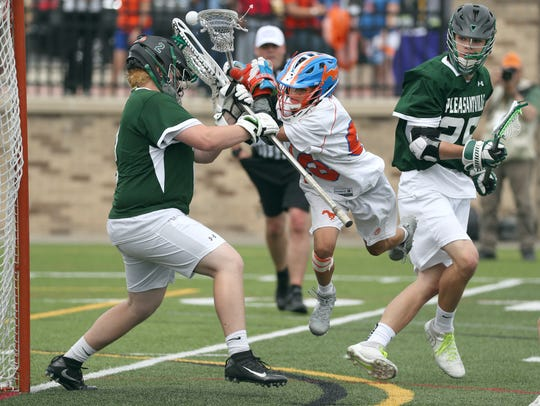 Penn Yan's Ayden Mowry fights through the crease to