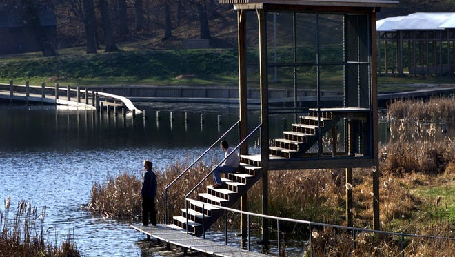 Sloping walkways and observation decks are part of an environmental-art installation at Greenwood Park on Des Moines' west side.