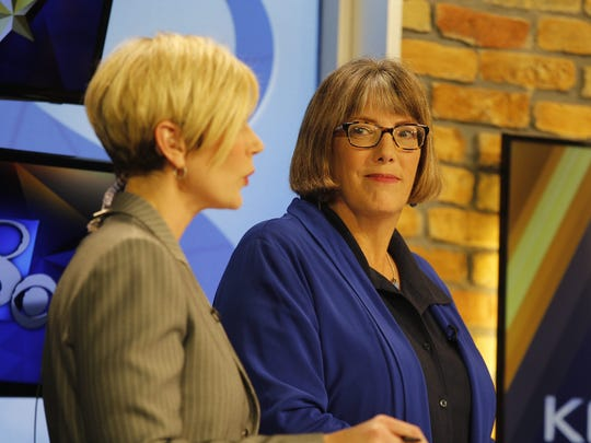 KCCI anchor Stacey Horst and Des Moines Register political columnist Kathie Obradovich moderate a debate involving Democratic candidates for Iowa's 3rd Congressional District in May 2016.