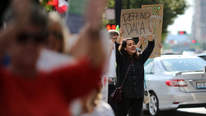 Demonstrators gather to the protest the winding down of the Deferred Action for Childhood Arrivals (DACA) program, Tuesday, Sept. 5, 2017, at the intersection of Walnut and Third Streets in downtown Cincinnati. The Obama-era immigration program was designed to protect undocumented immigrants who were brought into the United States as children.