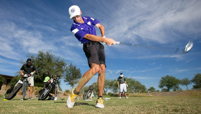 Sunrise Mountain senior Mark Hernon warms up on the driving range during high school golf practice at Trilogy Golf Club at Vistancia in Peoria on Wednesday, September 30, 2015.