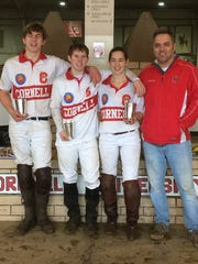 Sam Quinn-Jacobs, Michael Koski, Anna Ullmann and Coach Anthony M. Condo Jr., of the Cornell Interscholastic Polo Team, are shown following the first round of Northeast Preliminary games in January, where the team went undefeated.