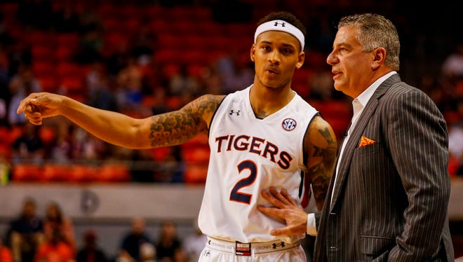Auburn guard Bryce Brown (left) talks to coach Bruce Pearl (right) during a game.