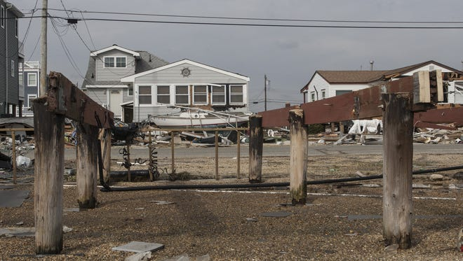 Only pilings remained of several bayfront homes on Parker Road in Tuckerton in November 2012.