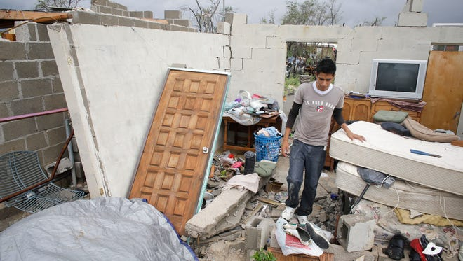 Raimundo Diaz, 17, walks inside what used to be a bedroom after his family's house was destroyed by Hurricane Odile in Los Cabos, Mexico, Monday, Sept. 15, 2014. Hundreds for impoverished housed were destroyed in the Unidad Real land invasion and other equally poor neighborhoods. Mexicoís Interior Ministry declared a state of natural disaster for affected areas in the state of Baja California Sur.