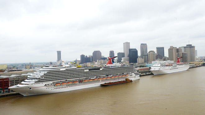 The Port of New Orleans and Carnival Cruise Lines signed a new pact that commits the line to operating two ships year-round from NOLA through 2019. Pictured here are the Carnival Dream and Carnival Elation.