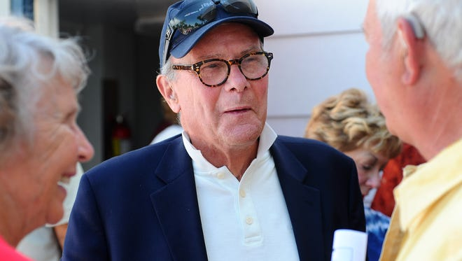 Tom Brokaw talks with former residents outside of the Pickstown and Fort Randall Dam Museum in Pickstown, S.D. on Friday, June 13, 2014.