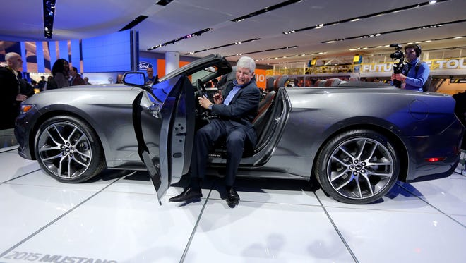 Michigan Gov. Rick Snyder gets out of a 2015 Ford Mustang convertible during the 2014 North American International Auto Show in Detroit