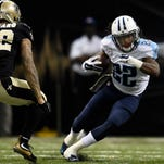 Titans running back Dexter McCluster (22) races past Saints strong safety Kenny Vaccaro (32) during the second quarter.