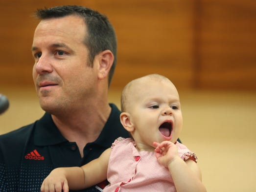 U of L Women's basketball Coach Jeff Walz brought his daughter Lola to his press conference today. July 15, 2014