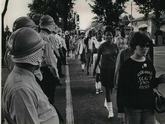 Police form a wall between civil rights demonstrators