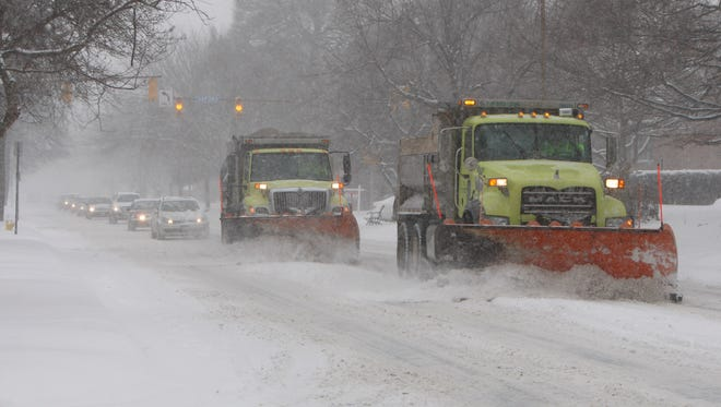 City snow plows were out in force clearing East Avenue as heavy snow blanketed Rochester earlier this month on Feb. 5.