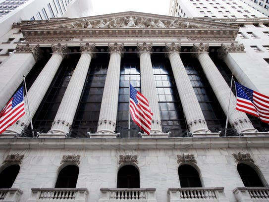 American flags fly in front of the New York Stock Exchange.