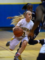 Elco's Taylor Bossert takes the ball inside during