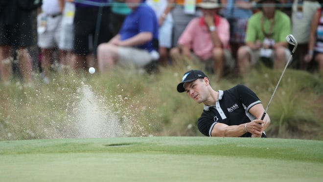 Martin Kaymer hits from the bunker on the 7th hole during the second round of the 2014 U.S. Open golf tournament at Pinehurst Resort Country Club.