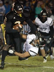 Hendersonville's Anthony Hughes rushes through the