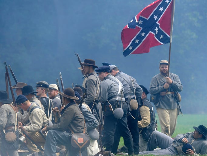 Reenactors recreate scenes from the military camps during the Pipestone Civil War Days in Pipestone, Minn., Saturday, Aug. 9, 2014.