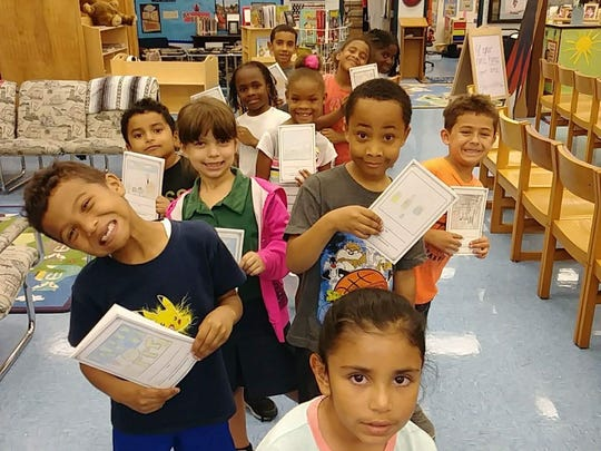 1 PSL Church and First United Methodist Church of Port St. Lucie collected 2,468 books for the students of Northport K-8.