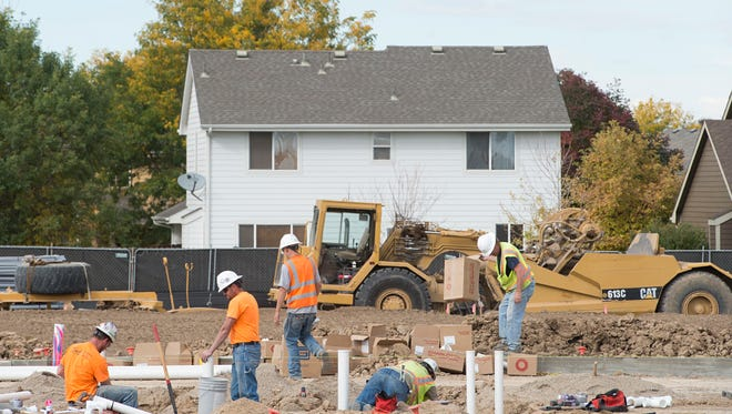 The early stages of construction continue on the Affinity housing project in south Fort Collins on Tuesday. The development will be restricted to residents age 55 and older.