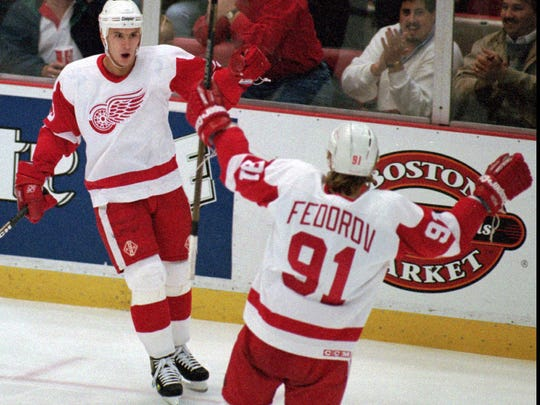 Red Wings' Vyacheslav Kozlov, left, celebrates his first period goal with Sergei Federov against the Edmonton Oilers at Joe Louis Arena in Detroit on Tuesday, Nov. 7, 1995.