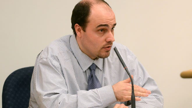 William Cormier III, who is accused of killing a former Pensacola News Journal reporter for his collection of Magic: The Gathering game cards, takes the stand in his own defense Wednesday, Feb. 12, 2014.