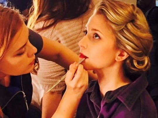 """Nicole Signore sits for make-up during """"The Girl Who"""