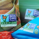 Labels on bags of snack foods in Los Angeles indicate they are non-GMO food products.
