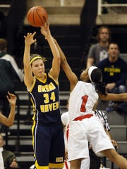 Abby Cole won two Class A state basketball titles at Grand Haven.