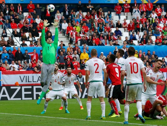 Hungary goalkeeper Gabor Kiraly, left, leaps for the ball during the Euro 2016 Group F soccer match between Austria and Hungary at the Nouveau Stade in Bordeaux, France, Tuesday, June 14, 2016. (AP Photo/Hassan Ammar)